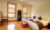 Asahi Lodge Bedroom with Wooden Floor | Hirafu, Niseko | Ministry of Chalets