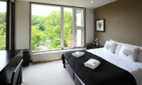 Big Valley Bedroom with Table | Hirafu, Niseko | Ministry of Chalets