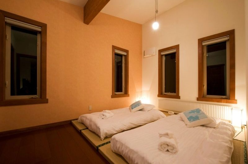 Cocoa Bedroom with Lamps | Hirafu, Niseko | Ministry of Chalets