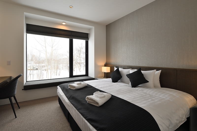 Jun Bedroom with Table | Hirafu, Niseko | Ministry of Chalets