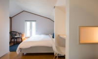 Kuma Cabin Bedroom with Seating | Hirafu, Niseko | Ministry of Chalets
