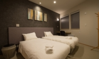 The Orchards Niseko Kitsune Twin Bedroom with Study Table | St Moritz, Niseko | Ministry of Chalets