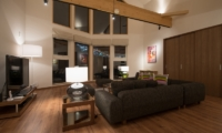 The Orchards Niseko Kuromatsu Living Area Night View | St Moritz, Niseko | Ministry of Chalets