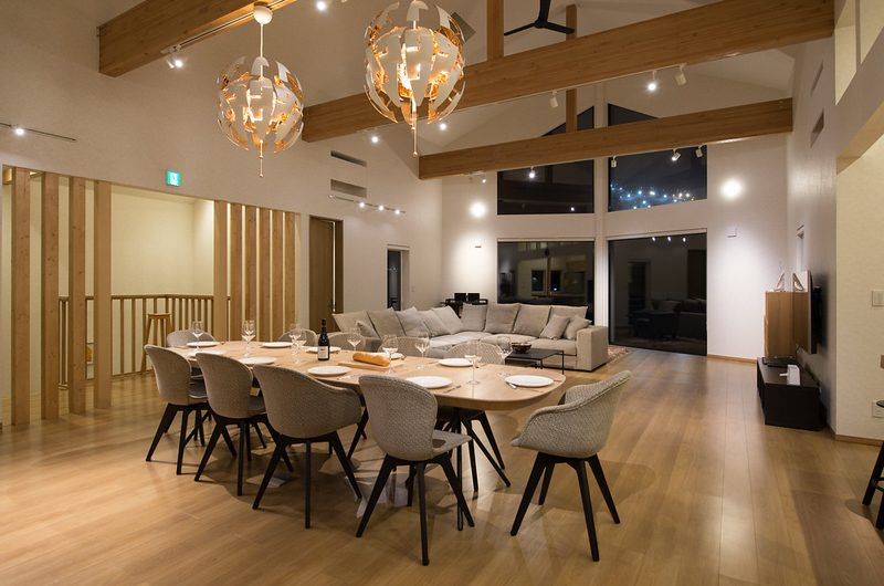 The Orchards Niseko Sawara Living and Dining Area Night View | St Moritz, Niseko | Ministry of Chalets